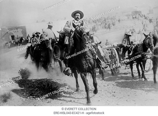 Movie still of Pancho Villa in a cavalry charge, Battle of Ojinga, Chihuahua, Jan. 1914. Alternatively, it may be from a re-enactment filmed for THE LIFE OF...