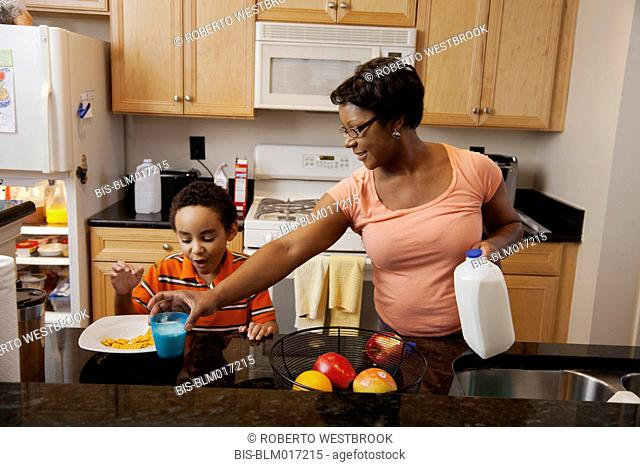 Mother making lunch for son in kitchen