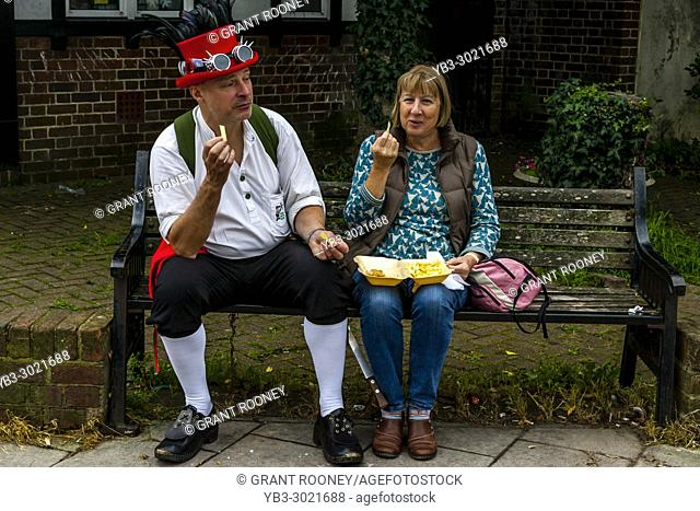 A Couple Eating Fish and Chips During The Annual Lewes Folk Festival, Lewes, Sussex, UK