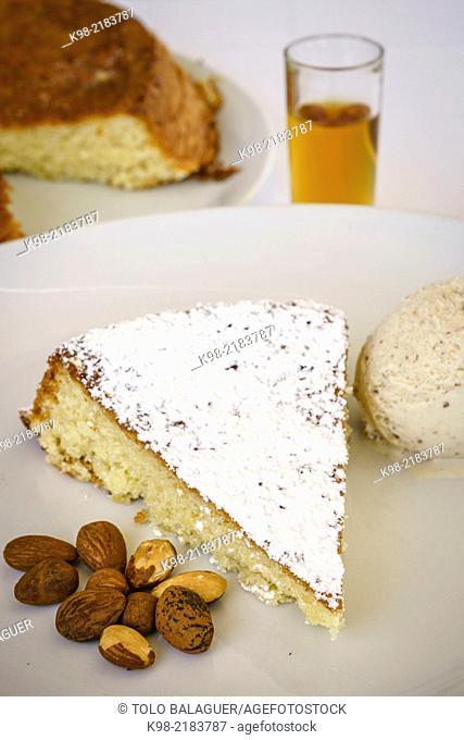 Gató d'Ametlla (typical majorcan cake) with ice cream. Majorca, Balearic Islands, Spain