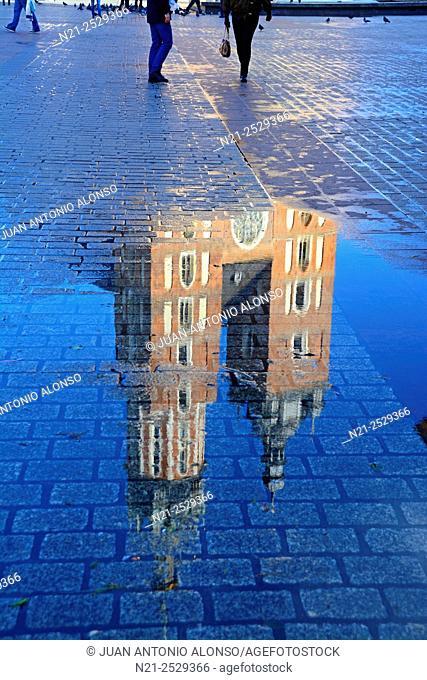 Saint Mary's Church reflection in the Rynek Glowny -Main Square-. Krakov, Poland, Europe