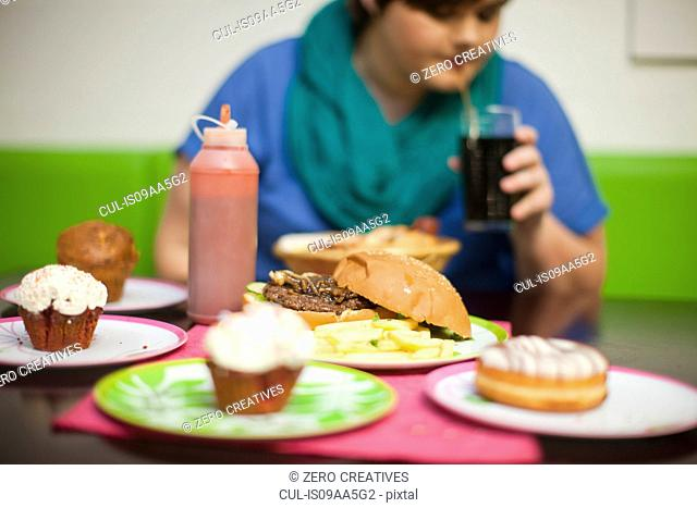 Young woman in cafe with table of food