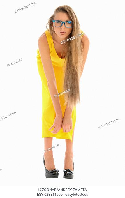 Young woman in yellow dress and with glasses