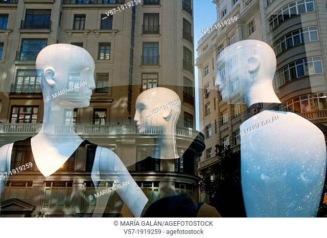 Three mannequins in a shop window. Gran Via, Madrid, Spain