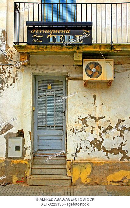 hairdressing and housing, Linyola, Lleida, Catalonia, Spain