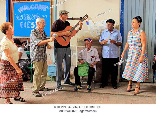 senior citizens musicians women and men entertain guests at a social club Santa Clara Cuba