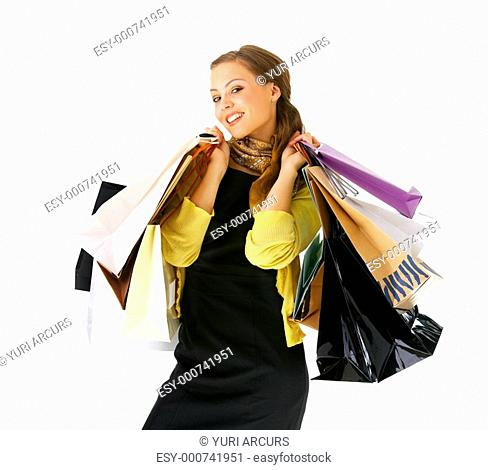 Portrait of an attractive young woman holding several shoppingbags