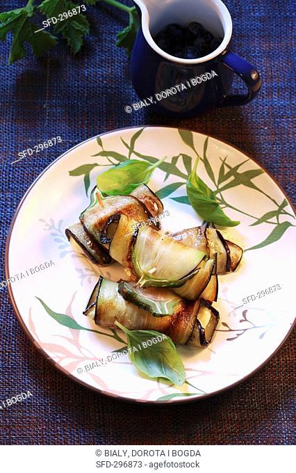 Aubergine rolls with basil