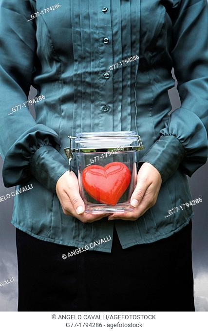 Woman holding a jar with a heart