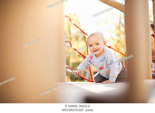 Portrait of happy baby girl on playground