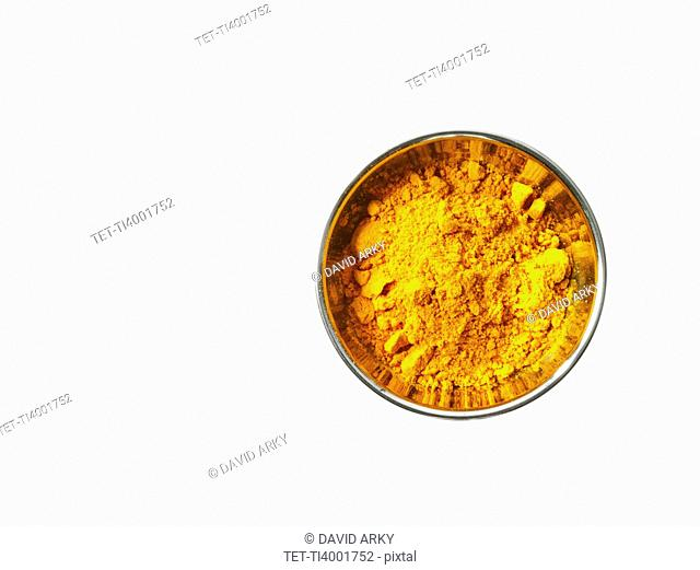 Studio shot of Curry Powder in pan on white background