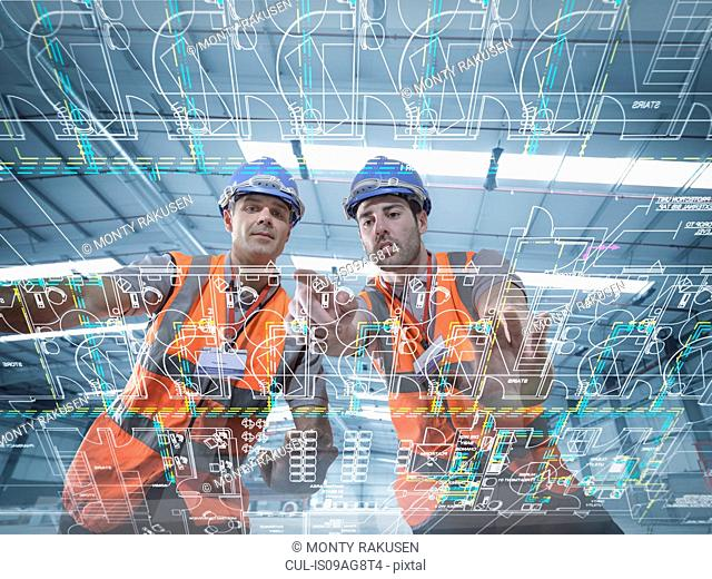 Builders looking at plans through an interactive display