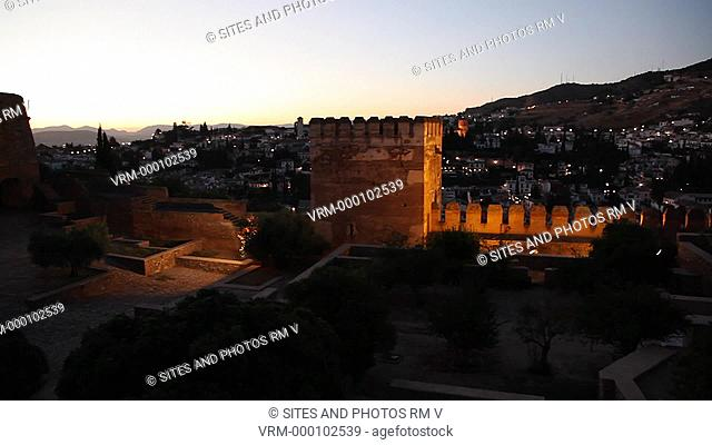 PAN, exterior, dusk. In 889 the Alcazaba was partially built by Savvar ben Hamdu. It was later extended on various occasions and in the 11th century the castle...