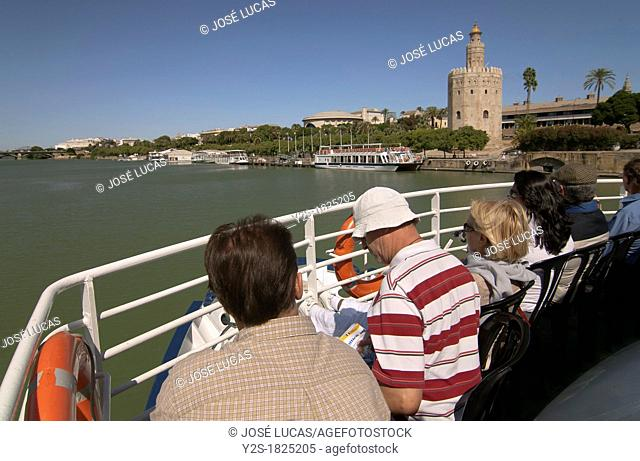 Sightseeing on the river Guadalquivir and Gold tower, Seville, Spain