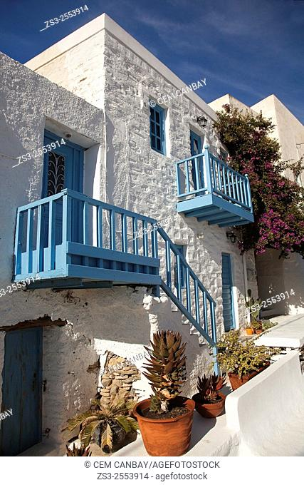 Whitewashed house with colorful balcony and windows in Ano Syros, Syros Island, Cyclades Islands, Greek Islands, Greece, Europe