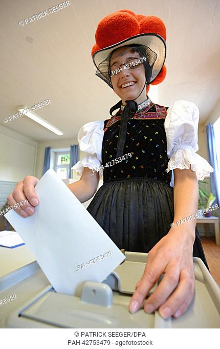 Gerlinde Moser casts her vote while wearing traditional Black Forest costume at a polling station in Hornberg-Reichenbach, Germany, 22 September 2013