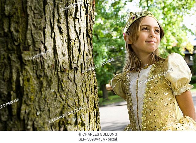 Girl wearing crown dressed up as queen