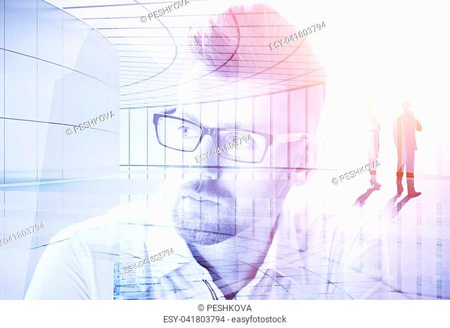 Portrait of attractive businessman on abstract city background. Occupation, lifestyle and employment concept. Double exposure