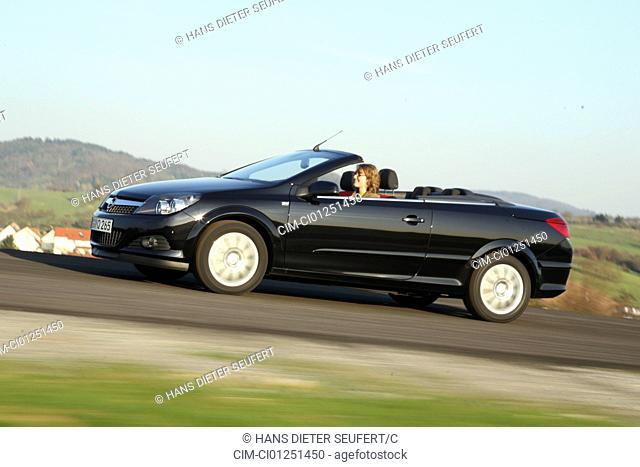 Opel Astra 1.9 CDTi Twin Top Edition, model year 2007-, black, driving, diagonal from the front, side view, country road, open top