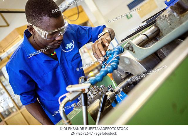Fitting and Turning Trade of the Windhoek Vocational Training Centre, Namibia. Students work with Lathe machine making a workpiece for turning
