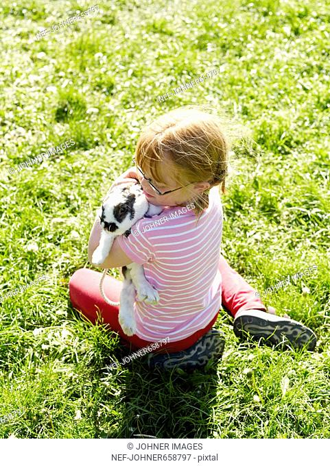 A girl with her rabbit, Sweden