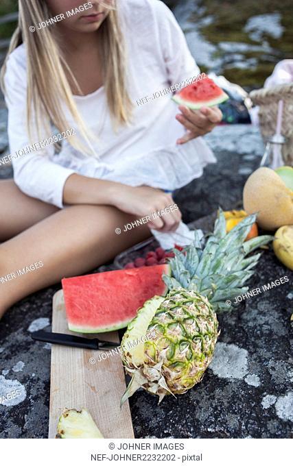Girl cutting fruits