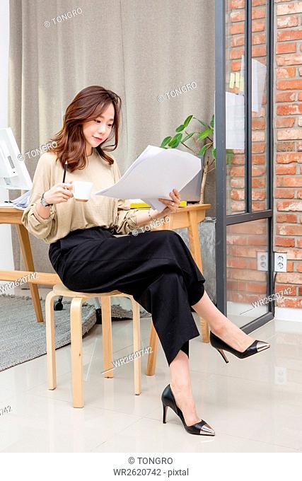 Young smiling female interior designer