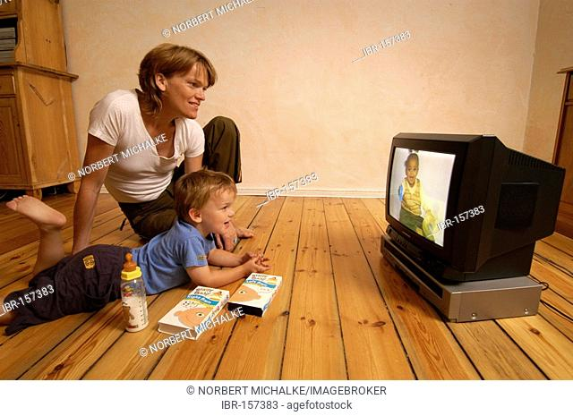 Mother and child watching a video
