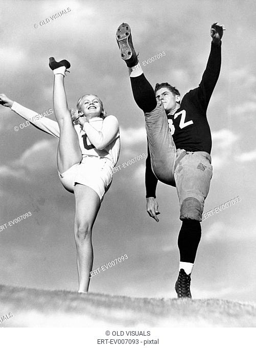 Cheerleader and football player kicking into the air All persons depicted are not longer living and no estate exists Supplier warranties that there will be no...