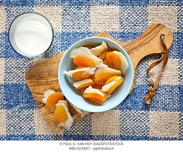stuffed apricots with parmesan and a glass of milk - healthy snack