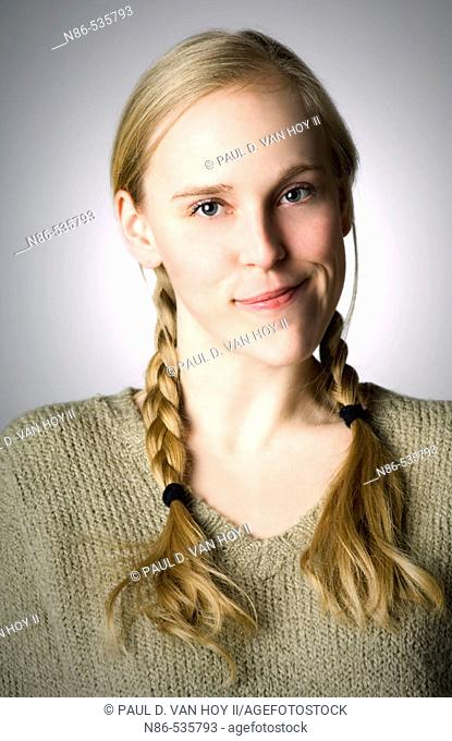 Young girl in braids smiling