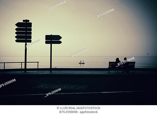 Promenade du Soleil with a couple sitting on a bench, two people on a platform at the sea, and in the foreground two sign post