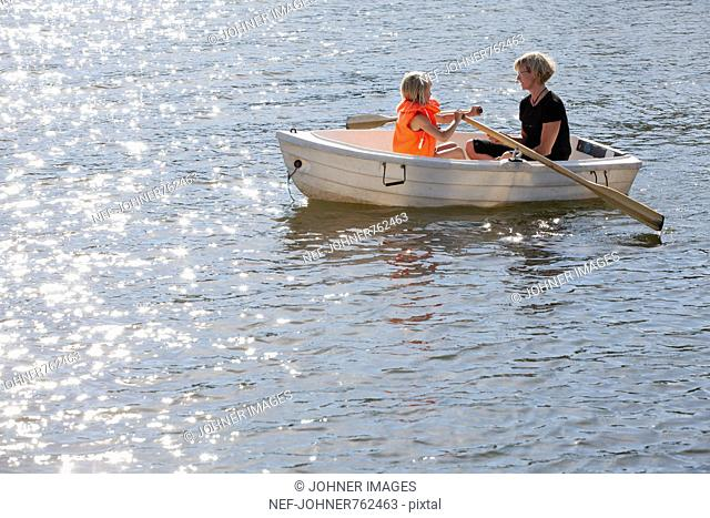 Mother and daughter in a rowboat, Sweden