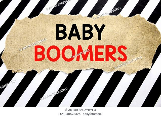 Handwritten text showing Baby Boomers. Business concept writing for Demographic Generation Written on note paper, background with space