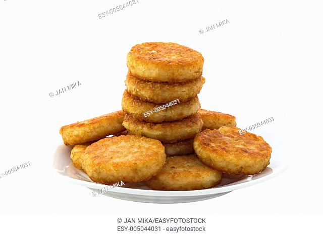 Hash browns on white plate Image is isolated on white background with clipping path