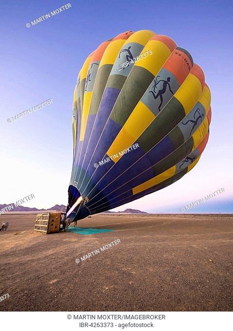 Hot air balloon being heated up, Kulala Wilderness Reserve, Namib Desert, Tsaris Mountains, Hardap Region, Namibia