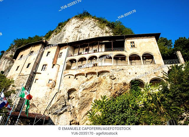View of the hermitage of Santa Caterina del Sasso from the deck of the boat that sails on the waters of Lake Maggiore, Italy