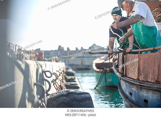Fishermen working on trawler