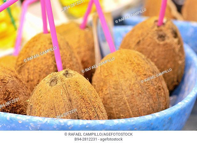 Coconuts for sale at Sant Josep aka la Boqueria market. Barcelona, Catalonia, Spain
