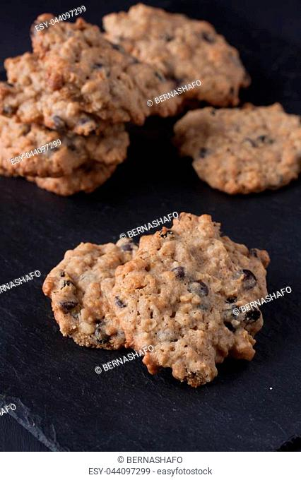 Oatmeal cookies on a black background