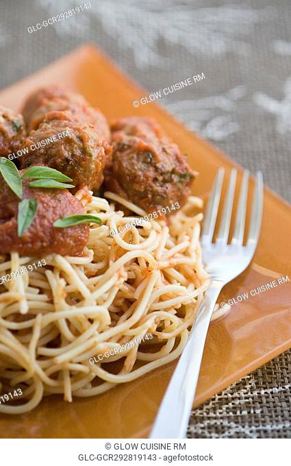 Close-up of spaghetti and meatballs with a fork