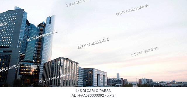 City skyline against pastel-colored sky, panoramic view