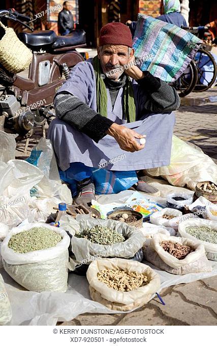 Morocco Marrakesh Place Rahba Kedima (Place des Epices) Street vendor selling herbs