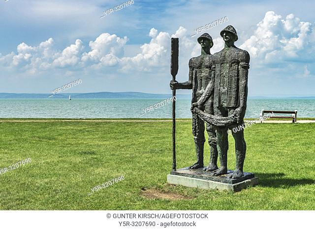 The statue of fishermen was created in 1971 by Jozsef Somogyi. Since 1998, the sculpture is located near the rose garden on the shore of Lake Balaton in Siofok