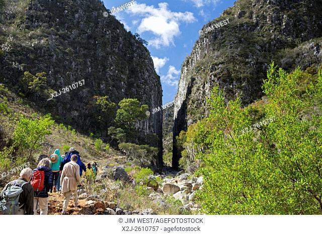 Santiago Apoala, Oaxaca, Mexico - Tourists hike near the village of Apoala, a small mountain town inhabitated by the Mixtec ethnic group