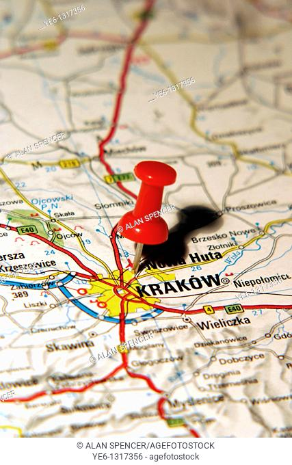 Map Pin pointing to the City of Krakow, Poland on a road map