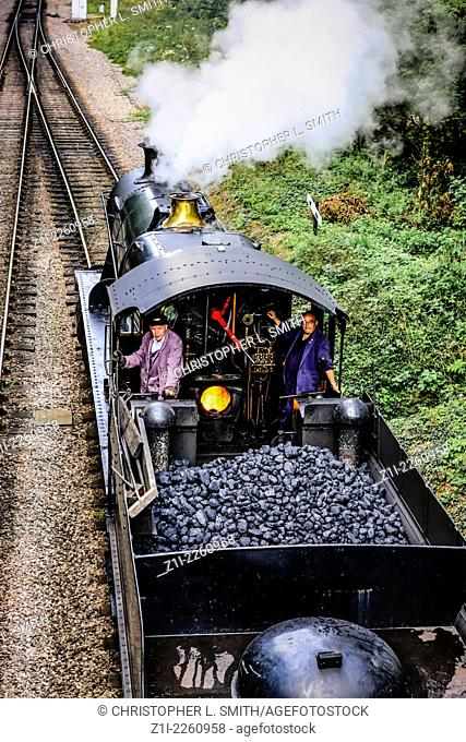 Steam locomotive seen from above with it's tender full of coal