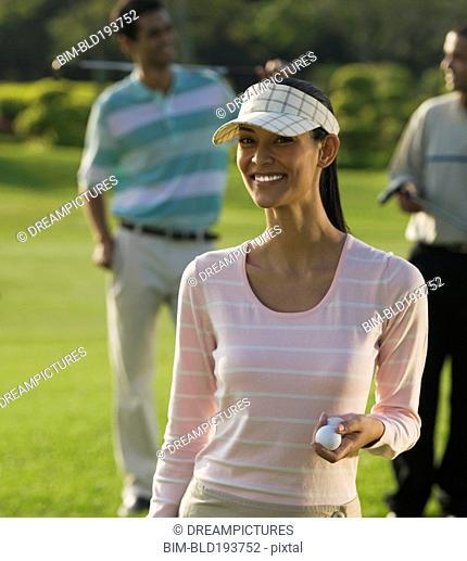 Pilipino woman golfing with friends