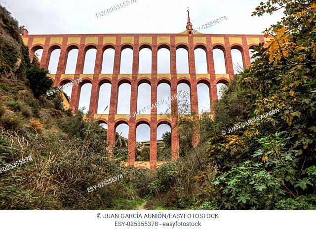 Aqueduct Puente del Aguila or Eagle Bridge in Nerja, Malaga, Spain. Low angle view