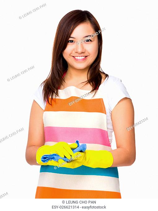 Asian young housewife hold with rubber gloves and rag